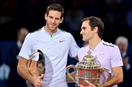 BASEL, SWITZERLAND - OCTOBER 29: Runner-up Juan Martin Del Potro of Argentina and winner Roger Federer of Switzerland after the final match of the Swiss Indoors ATP 500 tennis tournament against of Juan Martin Del Potro of Argentina at St Jakobshalle on October 29, 2017 in Basel, Switzerland. (Photo by Harold Cunningham/Getty Images)